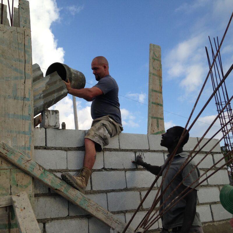 men rebuilding church
